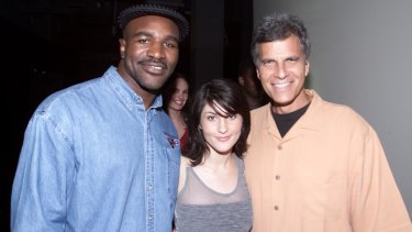 Evander Holyfield at the Last Lap, with singer Leah Haywood and American swimming legend Mark Spitz.