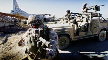 Australian SAS soldiers on patrol near Bagram, Afghanistan, September 2002.