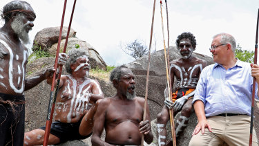 Prime Minister Scott Morrison with people of the Guugu Yimidhirr tribe at Reconciliation Rocks earlier this year.