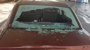 A smashed rear windscreen at a service station in Moorebank.