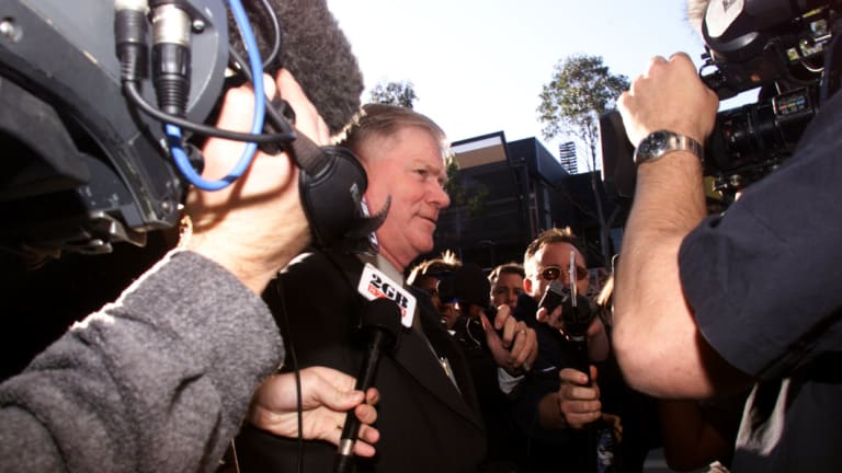 In the spotlight: Bulldogs chief executive Bob Hagan arrives at NRL headquarters to answer questions about breaking the salary cap in 2002.