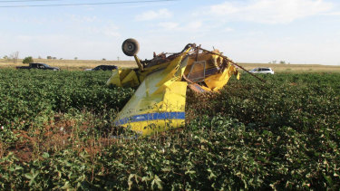 The wreckage of a crop-dusting plane that, according to safety officials, stalled after dumping hundreds of litres of pink water as part of a gender reveal celebration, near Turkey, Texas.