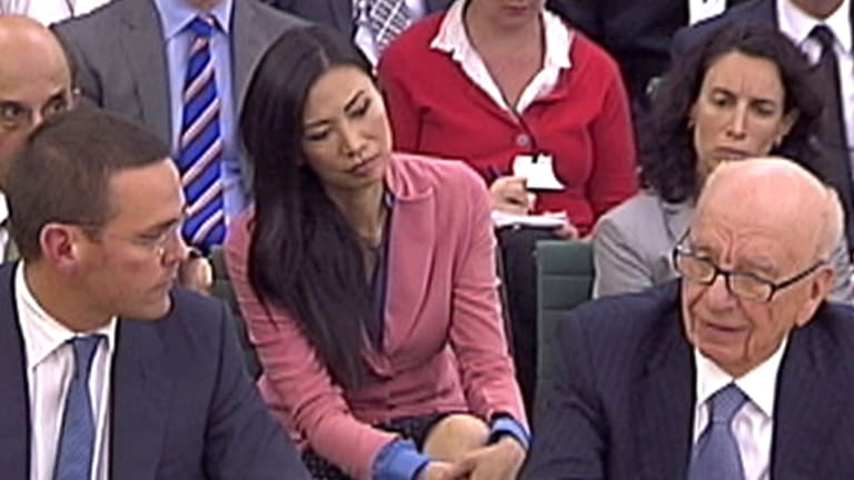 Rupert Murdoch's wife Wendi Deng (C) looks on as BSkyB Chairman James Murdoch and News Corp Chief Executive and Chairman Rupert Murdoch (R) appear before a parliamentary committee on the phone hacking scandal.
