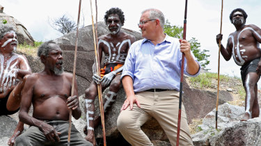 Prime Minister Scott Morrison with the people of the Guugu Yimithirr tribe at Reconciliation Rocks, Cooktown.