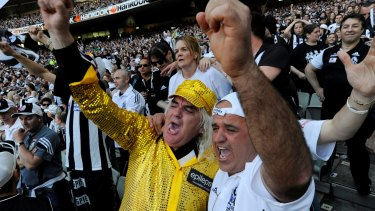 Joffa celebrates in the last quarter of the 2010 grand final replay with Collingwood fans.