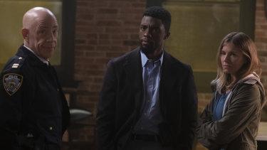J.K. Simmons (left), Chadwick Boseman and Sienna Miller in 21 Bridges.