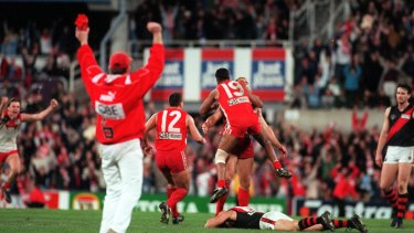 Sydney Swans players congratulate Tony Lockett after he kicked a behind to put them through to the grand final.