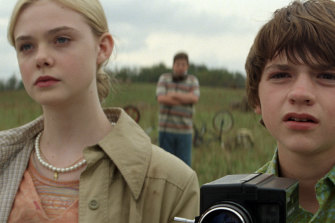 Elle Fanning and Joel Courtney in Super 8, in which she plays a girl cast as a zombie.