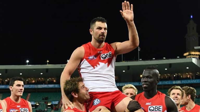 Milestone: Heath Grundy is chaired off the field by teammates after his 250th game.