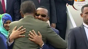 Ethiopian Prime Minister Abiy Ahmed is welcomed by Eritrean President Isaias Afwerki as he arrives in Eritrea on Saturday.