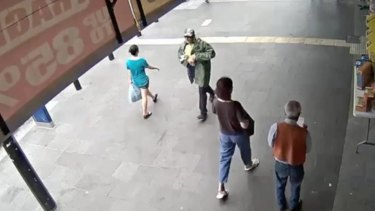 Arthur Kelekolio (green jacket) pictured on City Plaza in Bankstown shortly before killing Ho Ledinh.