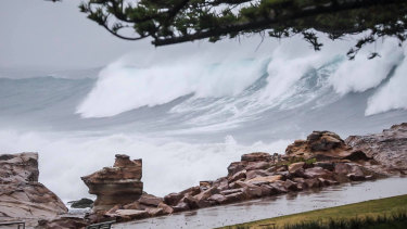 Massive waves slam the NSW coast as a deep low pressure system churns up the Tasman Sea.