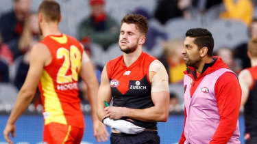 Cruel blow: Demon Joel Smith leaves the ground after being injured in a tackle against the Suns.