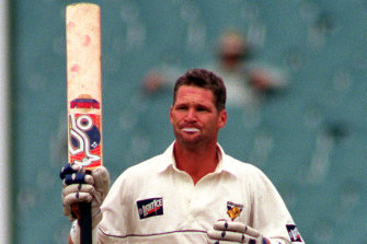"The late Dean Jones, pictured at the MCG in 1996, answered to ""Legend""."