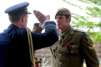 Then Defence Force chief Angus Houston salutes Victoria Cross recipient Ben Roberts-Smith in 2011.
