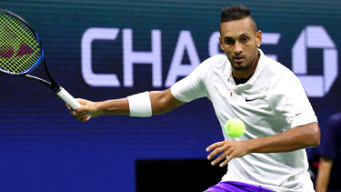 Taking a swing: Kyrgios in the backcourt against Rublev.