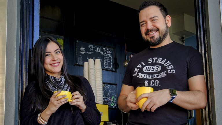 Latin Americans in Melbourne:  Isabel Arias and Diego Reyes outside Reyes' cafe Cento Mani.