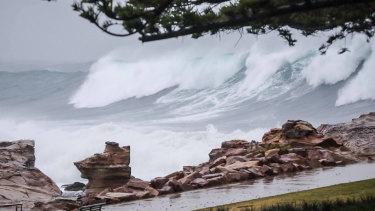 Massive waves slam the NSW coast as a deep low pressure system churns up the Tasman Sea.