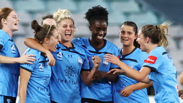 Ellie Brush celebrates derby goal and another victory with her Sydney FC teammates.