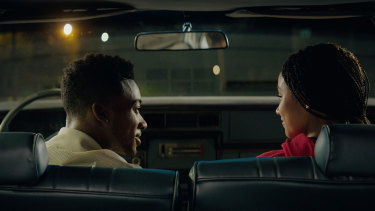 Algee Smith as Khalil and Amandla Stenberg as Starr.
