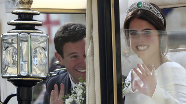 Britain's Princess Eugenie of York and her husband Jack Brooksbank in the Scottish State Coach after their wedding.