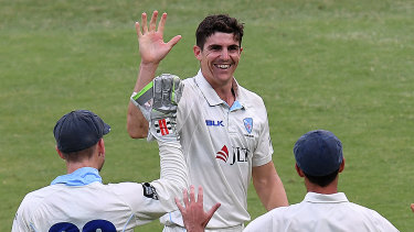 Spearhead: Sean Abbott celebrates after taking his fifth wicket against Queensland at the Gabba.