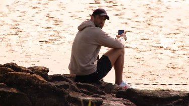 Paul Vaughan at the beach on Tuesday after being sacked by the Dragons for hosting a house party on Saturday.