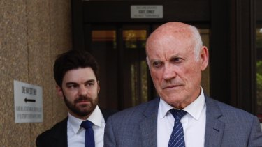 Ian Macdonald, right, arrives at court on Monday with his barrister Jonathan Martin. Macdonald is facing a five-month long trial for misconduct in public office over a mining deal.