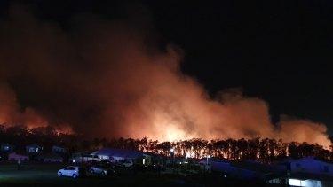 A fire rages at Peregian Beach on Sunshine Coast.