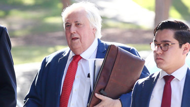 Businessman Clive Palmer arrives at the District Court in Brisbane on Thursday.