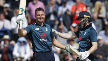 Commanding: Jos Buttler (left) celebrates his century against Pakistan.