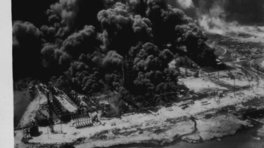 """An aerial view of burning industrial plants after an explosion aboard a French vessel in the harbor here today. April 1947."""
