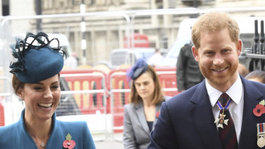 Britain's Prince Harry, the Duke of Sussex, right and Kate, the Duchess of Cambridge arrive for the Anzac Day Service of Commemoration and Thanksgiving at Westminster Abbey.