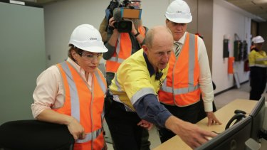Energy Minister Dr Anthony Lynham and Treasurer Jackie Trad inside CleanCo's hydroelectricity plant at Wivenhoe Dam.