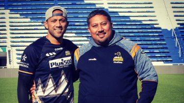Surprise reunion: Christian Lealiifano was presented with his match jersey by brother Eddie, who had flown to Buenos Aires.