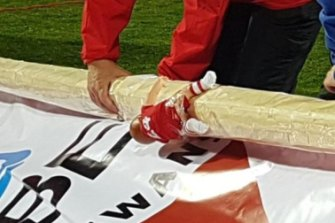Look closely: A Dane Rampe doll clings to the side of the Sydney banner post
