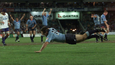 'Halcyon days': Scott Staniforth scores for the Waratahs in the side's record-breaking 2002 season.