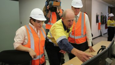 Energy Minister Dr Anthony Lynham and Treasurer Jackie Trad inside CleanCo's hydroelectricity plant at Wivenhoe Dam on Thursday.
