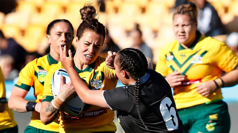 Jillaroo Isabelle Kelly, tackled by New Zealand's Raecene McGregor earlier this year, claimed the women's award.