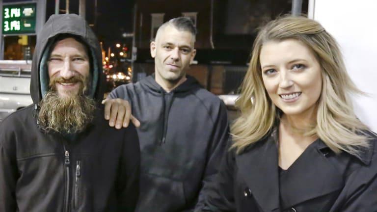Johnny Bobbitt, left, Kate McClure, and McClure's boyfriend Mark D'Amico in Philadelphia last November.