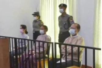 Deposed Myanmar leader Aung San Suu Kyi, left, was shown on TV sitting in court.