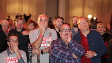 Shocked Labor supporters watch the results roll in on election night.
