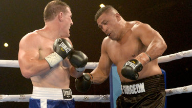 Paul Gallen (left) and John Hopoate in action during the Star of the Ring charity fight night at Hordern Pavilion.