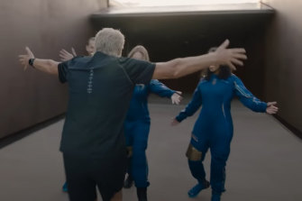 The clip also shows Branson greeting crewmates dressed in their flight suits.