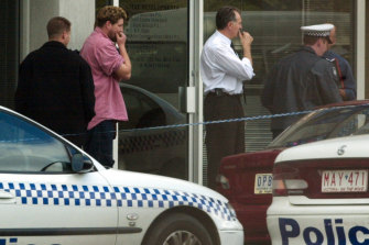 Bystanders at the scene of a fatal shooting at The Fertility Control Clinic in Wellington Parade, East Melbourne.