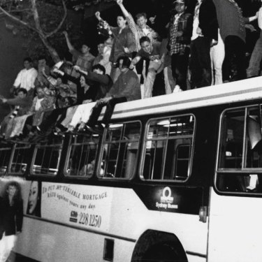 Sydneysiders celebrate on top of a bus in George Street after the announcement in Monte Carlo. September 24, 1993.