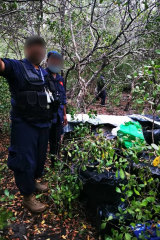 Police found what they believe was cocaine hidden away in PNG after a plane crash.