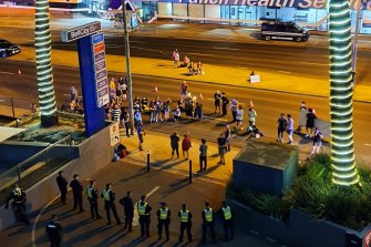Police and protesters outside the Mantra hotel in Preston on Monday night.