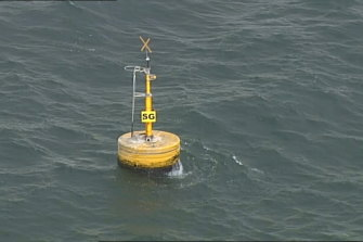 Aerial footage of the buoy in Port Phillip Bay where the sailor was found.