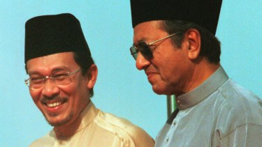 Anwar Ibrahim, left, stands next to Malaysian Prime Minister Mahathir Mohamad in 1998.